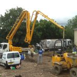 Boom extending from a truck-mounted concrete pump