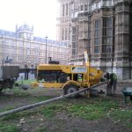 Static line running from a trailer-mounted concrete pump in London