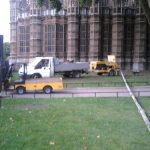 Static line running to trailer-mounted concrete pump in London