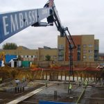 Schwing 34m Reach Concrete Boom Pump in operation at a construction site