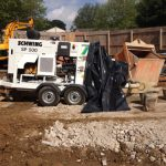 Schwing SP 500 concrete trailer pump on-site