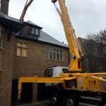 CIFA 42m concrete boom pump - pumping over the top of a house
