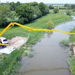 Cifa 36m concrete boom pump at work over the River Adur