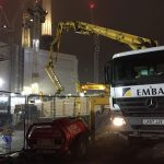 Schwing 24X 24m reach concrete boom pump working at night