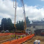 Sermac 36m concrete boom pump at work on a swimming pool project