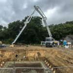 Schwing 28m pouring a reinforced Concrete basement slab in Mayfield East, Sussex